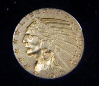 A gold 5 dollar coin