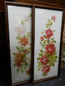 A pair of early 20th century florally painted glass panels