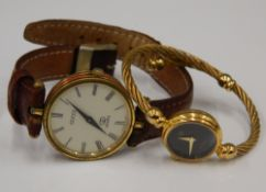 Two Gucci watches