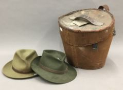 Two felt hats and a Victorian top hat box
