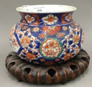 A 19th century Imari bowl on stand