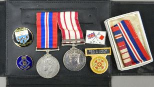 A quantity of military medals, including WWII and Palestine.