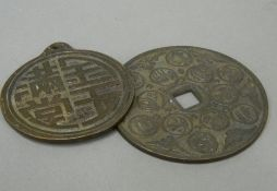 Two Chinese bronze tokens