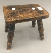 A 19th century elm topped stool
