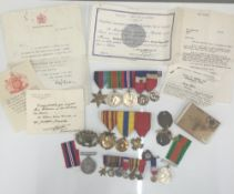 A collection of WWII medals, including Medaille d'Honneur du Travail (Argent),