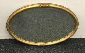 A 19th century gilt framed oval mirror