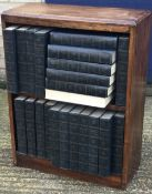 An early 20th century bookcase and books