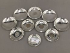 A quantity of small Chinese sterling silver coin set dishes and other unmarked small dishes (14 .
