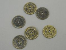 Six Chinese brass coins