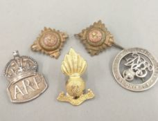 Two silver military badges, etc.