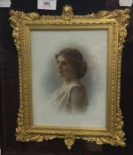 A late 19th century Female Portrait on milk glass,