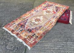 A Turkish wool rug and another