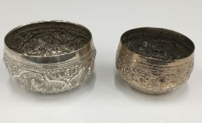Two Indian unmarked white metal embossed bowls (63.4 grammes). 6.5 cm and 7.