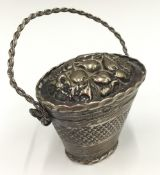 A Continental silver pill box formed as a basket (21 grammes)