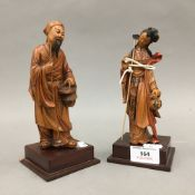 A pair of Chinese carved wooden figures
