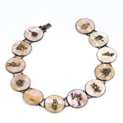 A 19th century Japanese silver and mother-of-pearl necklace, formed from twelve roundels,