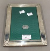 A boxed silver photograph frame. 22 x 17 cm.