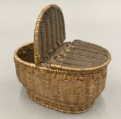 A vintage miniature wicker creel basket