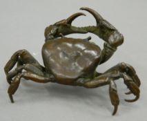 A Japanese bronze model of a crab. 10.5 cm wide, 8.5 cm deep.
