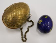 A brass egg shaped purse and a cloisonne egg