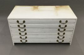 An early 20th century white painted plan chest. External measurements: 60 cm deep, 58 cm high.