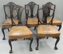 A set of five late Victorian mahogany dining chairs