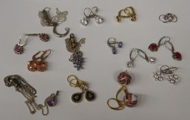 A box of various silver earrings and pendants