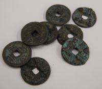 A bag of eight Chinese coins