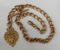 A 9 ct gold watch chain and fob (43.