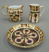 Two Royal Crown Derby jugs and a saucer