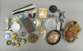 A quantity of miscellaneous objects, including paperweights, etc.