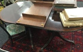 A reproduction pedestal dining table