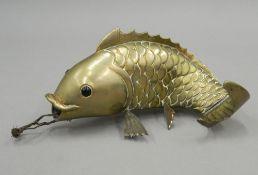 An Oriental brass model of a carp