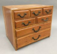 A small early 20th century bank of drawers. 35.5 cm wide, 24.5 cm deep, 29.5 cm high.