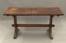 A Squirrelman adzed oak refectory table. 154 cm long, 65.5 cm wide. 75.6 cm high.