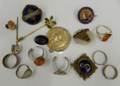 A small quantity of various jewellery, including rings, enamel brooches, etc.
