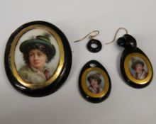 A 19th century porcelain mounted brooch and a pair of earrings en-suite