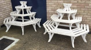 A pair of painted wooden garden stands