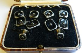 A cased set of studs and cufflinks