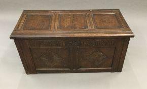 A late 17th century oak two panelled coffer