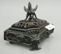 A patinated bronze censer
