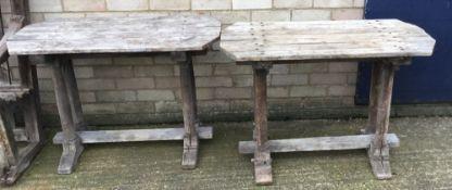 A pair of wooden garden tables