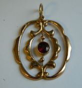 A 9 ct rose gold and garnet pendant (1.