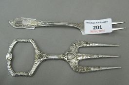 An unusual cake fork decorated with the SS insignia and plated bread fork