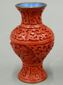 A small cinnabar vase