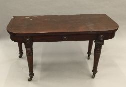 A 19th century mahogany concertina extending dining table