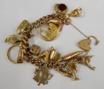 A 9 ct gold charm bracelet (some charms not gold) (70.
