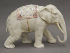 A large Continental porcelain model of an elephant. 21 cm high, 31 cm long.