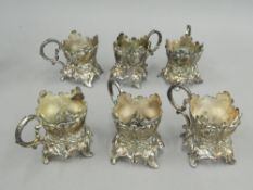A set of six plated cup holders