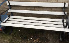 A wrought iron and wooden garden bench
